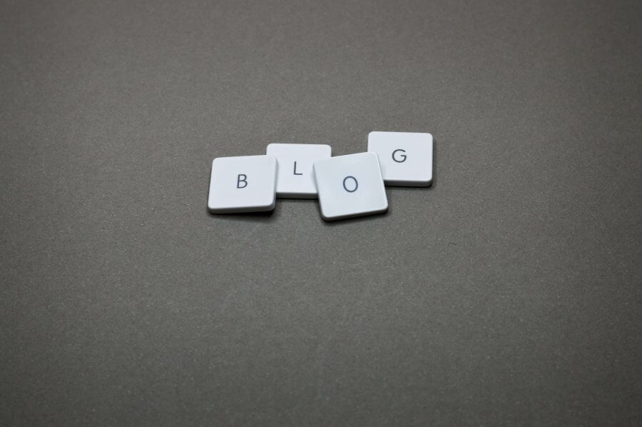 Four white tiles. Each has a black letter on it. Together, they spell BLOG