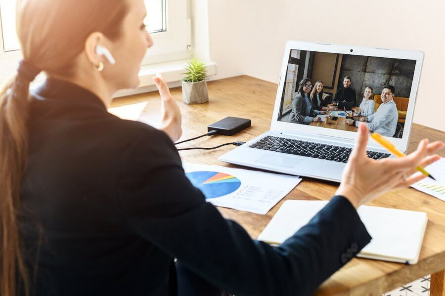 Writer talking to people via video chat on a laptop